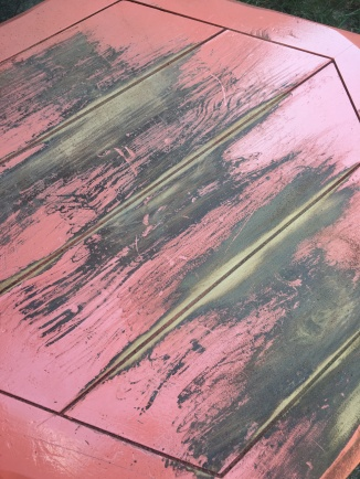 It had three layers: pink paint, black paint and a wood stain
